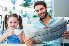 Happy father and his daughter having breakfast together Royalty Free Stock Photos