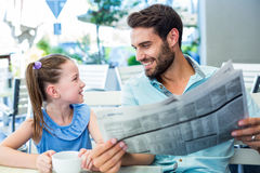 Happy father and his daughter having breakfast together Stock Photography
