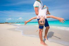 Happy father and his little cute girl enjoy summer vacation at perfect beach Royalty Free Stock Images