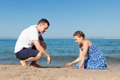 Happy father and his little daughter at beach Royalty Free Stock Image