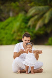 Happy father and his little daughter on the beach Stock Photos