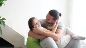 Happy father and his little daughter playing at home, close-up stock video footage