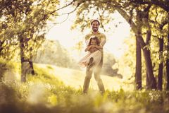 Happy father with his little girl in nature. Time for playing. royalty free stock image