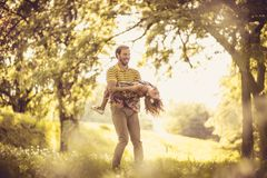 Happy father with his little girl in nature. Time for playing. royalty free stock photo