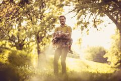 Happy father with his little girl in nature. Time for playing. stock photo