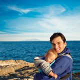 Happy Father with His Little Son in Carrier Stock Images
