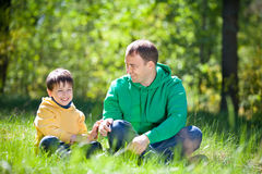 Happy father with his little son outdoors Stock Photos