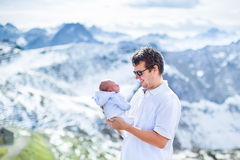 Happy father with his newborn baby in mountains Royalty Free Stock Photography