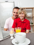 Happy father and his son having breakfast Royalty Free Stock Photography