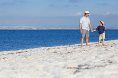 Happy father and his son having fun at the beach Stock Photography
