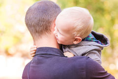 Happy father and his son outdoors. Child hugging daddy. Royalty Free Stock Images