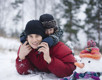 Happy father with his son outside with snowman royalty free stock photos