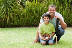 Happy father and his son playing baseball. Durring the summer Stock Photos