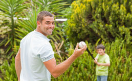 Happy father and his son playing baseball. Durring the summer Stock Image
