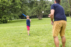 Happy father and his son playing baseball. A Happy father and his son playing baseball Stock Image