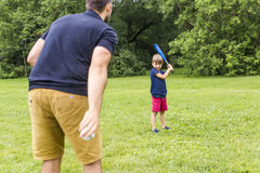 Happy father and his son playing baseball Royalty Free Stock Images