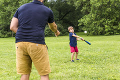 Happy father and his son playing baseball. A Happy father and his son playing baseball Royalty Free Stock Photos