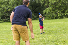 Happy father and his son playing baseball Stock Photo