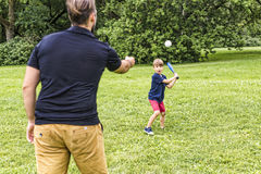 Happy father and his son playing baseball. A Happy father and his son playing baseball Royalty Free Stock Image