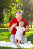 Happy father and his son playing in park together. Outdoor portr Royalty Free Stock Photo