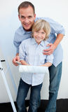 Happy father and his son renovating home Royalty Free Stock Images