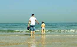 Happy father and his son on the sea Stock Photos