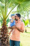Happy father and his sweet little daughter at beach stock photos