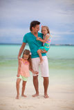 Happy father with his two daughters on tropical Stock Photo
