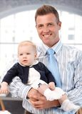 Happy father holding baby girl Stock Photos