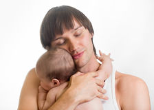 Happy father holding baby in his hands. Happy father holding baby boy in his hands Stock Photography