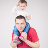 Happy father holding child at white background Stock Photo