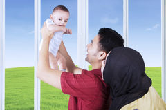 Happy father holding his baby at home Royalty Free Stock Photos