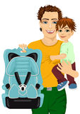 Happy father holding his son in one hand and a car seat in another Stock Images