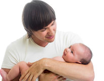 Happy father holding infant baby in his hands isolated Royalty Free Stock Photos