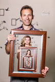 Happy father holding portrait with his family Royalty Free Stock Images