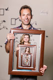 Happy father holding portrait with his family Royalty Free Stock Photos