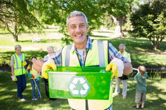 Happy father holding recycling case Royalty Free Stock Photos