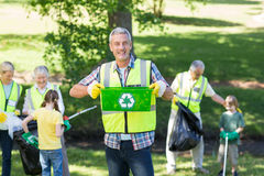 Happy father holding recycling case Royalty Free Stock Image