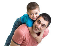 Happy father holding son on his back isolated on w Royalty Free Stock Image