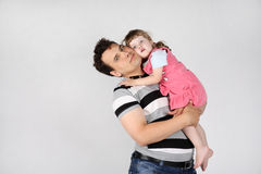 Happy father holds and hugs her little daughter Royalty Free Stock Photo