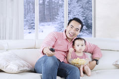 Happy father holds remote control Royalty Free Stock Photos
