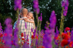 Happy father hugging little daughter Stock Image