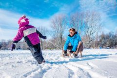 Happy father and kid with sledges stock photography