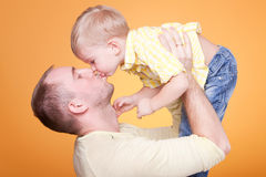 Happy father kiss his son Stock Photos