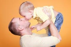 Happy father kiss his son. Closeup portrait Stock Photos