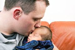 Happy Father Kisses His Newborn Royalty Free Stock Images