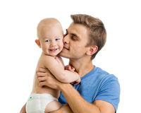 Happy father kissing baby boy isolated on white Stock Photography