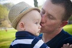 Happy Father Kissing Baby Son Stock Images