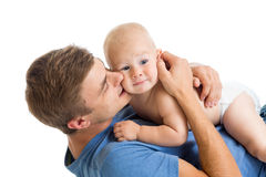 Happy father kissing his baby son. Isolated Royalty Free Stock Photo