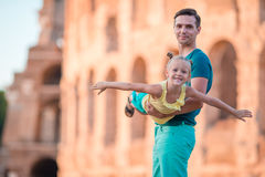 Happy father and little adorable girl in Rome during summer italian vacation background Colosseum Stock Photos